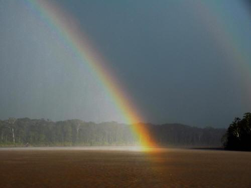 CLIMATE & WEATHER IN THE AMAZON RAINFOREST OF ECUADOR: Rainbow over rainshower Aguarico River.